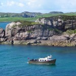 mv Iolaire in Bull Hole with Iona Abbey